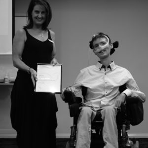 Noah Ryan being presented with Bronze Award